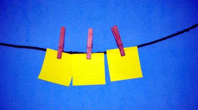 Picture of sticky notes hanging on a clothes line