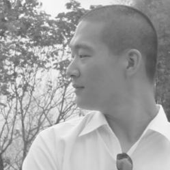 A black and white picture of Doug Yuen in black and white with a profile shot of his face.